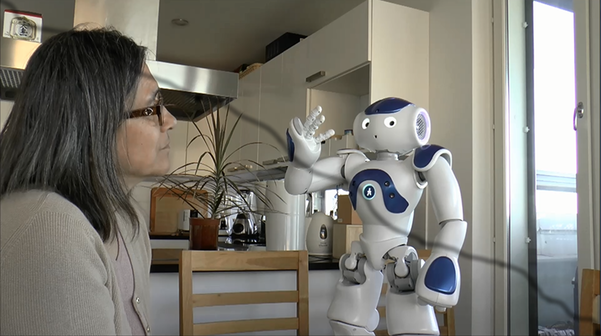 Kristiina with Nao robot at home